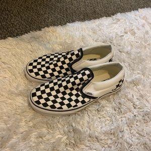 Checkered vans.